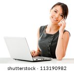 Business woman working on a laptop - isolated over a white background - stock photo