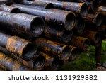 oil drill pipe. rusty drill... | Shutterstock . vector #1131929882