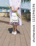 beautiful slim model in a dress ... | Shutterstock . vector #1131946196