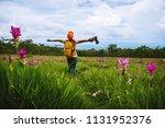 asian woman travel nature.... | Shutterstock . vector #1131952376