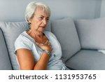 heart attack concept. woman... | Shutterstock . vector #1131953765