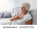 woman having a pain in the... | Shutterstock . vector #1131957722