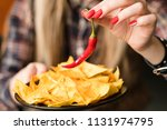 hot spicy chips. pungent fiery... | Shutterstock . vector #1131974795