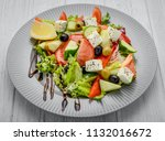 greek salad with vegetables and ... | Shutterstock . vector #1132016672