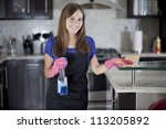 Happy Young Housewife Cleaning...