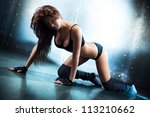 Young sexy fitness woman. Camera angle view. - stock photo