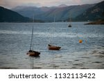 several small boats anchored on ... | Shutterstock . vector #1132113422