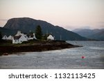 several white houses at sunset... | Shutterstock . vector #1132113425