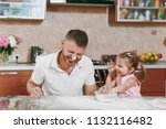 little kid girl play with man... | Shutterstock . vector #1132116482