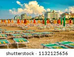 colorful chairs and sunshades... | Shutterstock . vector #1132125656