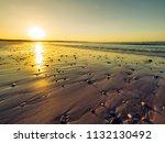 sunset of donegal beach ireland   Shutterstock . vector #1132130492