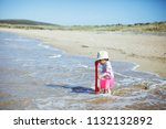 baby girl playing at summer...   Shutterstock . vector #1132132892