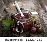 cherry jam in a preserving glass | Shutterstock . vector #113214262