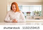 redhead woman at kitchen with... | Shutterstock . vector #1132153415