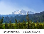 smoke carried by the wind from... | Shutterstock . vector #1132168646