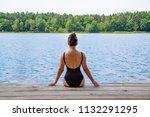 woman sitting on wooden dock... | Shutterstock . vector #1132291295