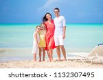 happy family on white beach on... | Shutterstock . vector #1132307495