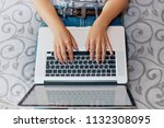 woman working on laptop... | Shutterstock . vector #1132308095