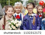 a group of schoolgirls with... | Shutterstock . vector #1132312172