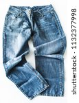 blue jeans lying on the floor... | Shutterstock . vector #1132377998