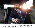 businessman reads information... | Shutterstock . vector #1132396928