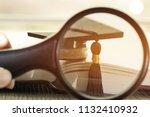 student hands holding... | Shutterstock . vector #1132410932
