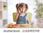 cute child little girl eating... | Shutterstock . vector #1132492745