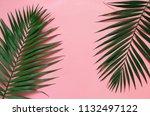 tropical palm leaves border... | Shutterstock . vector #1132497122
