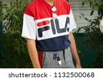 milan   june 16  man with fila... | Shutterstock . vector #1132500068