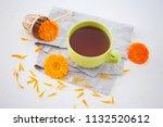 marigold or calendula herbal... | Shutterstock . vector #1132520612