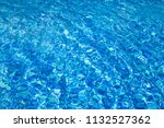 blue swimming pool background... | Shutterstock . vector #1132527362