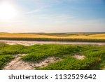 green field and beautiful sunset | Shutterstock . vector #1132529642