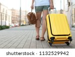 young woman with yellow carry... | Shutterstock . vector #1132529942