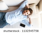 top view of a smiling young man ... | Shutterstock . vector #1132545758