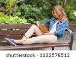 beautiful woman read an old... | Shutterstock . vector #1132578512