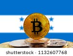 bitcoin btc on stack of... | Shutterstock . vector #1132607768