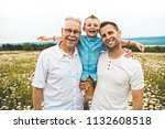 grandfather and son spending... | Shutterstock . vector #1132608518