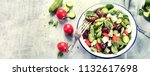 fresh salad with feta cheese.... | Shutterstock . vector #1132617698