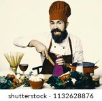 cook with curious face sits by... | Shutterstock . vector #1132628876