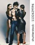 women in sexy bodysuits hug... | Shutterstock . vector #1132629596