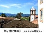 Small photo of View of the old village of Caria, Portugal, and beyond. Visible in the image is the bell tower of the Parish Church and the cross of the Chapel of Saint Anthony
