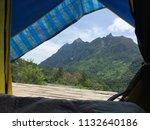 scenic view lying in tent...   Shutterstock . vector #1132640186