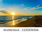 sunset sea sand beach landscape.... | Shutterstock . vector #1132656566