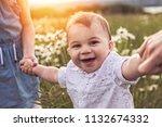 parent walking with her baby... | Shutterstock . vector #1132674332