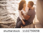 romantic couple hugging on... | Shutterstock . vector #1132750058