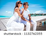 young couple in love at their... | Shutterstock . vector #1132762355