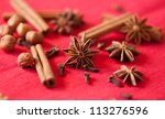 Variation of Christmas spices - star anise, cinnamon sticks and cloves - stock photo