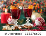 Two glasses of mulled wine with Christmas lights in the background - stock photo