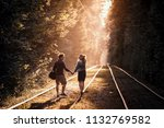 young happy couple walk along... | Shutterstock . vector #1132769582