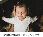 newborn baby feeling safe and... | Shutterstock . vector #1132778795